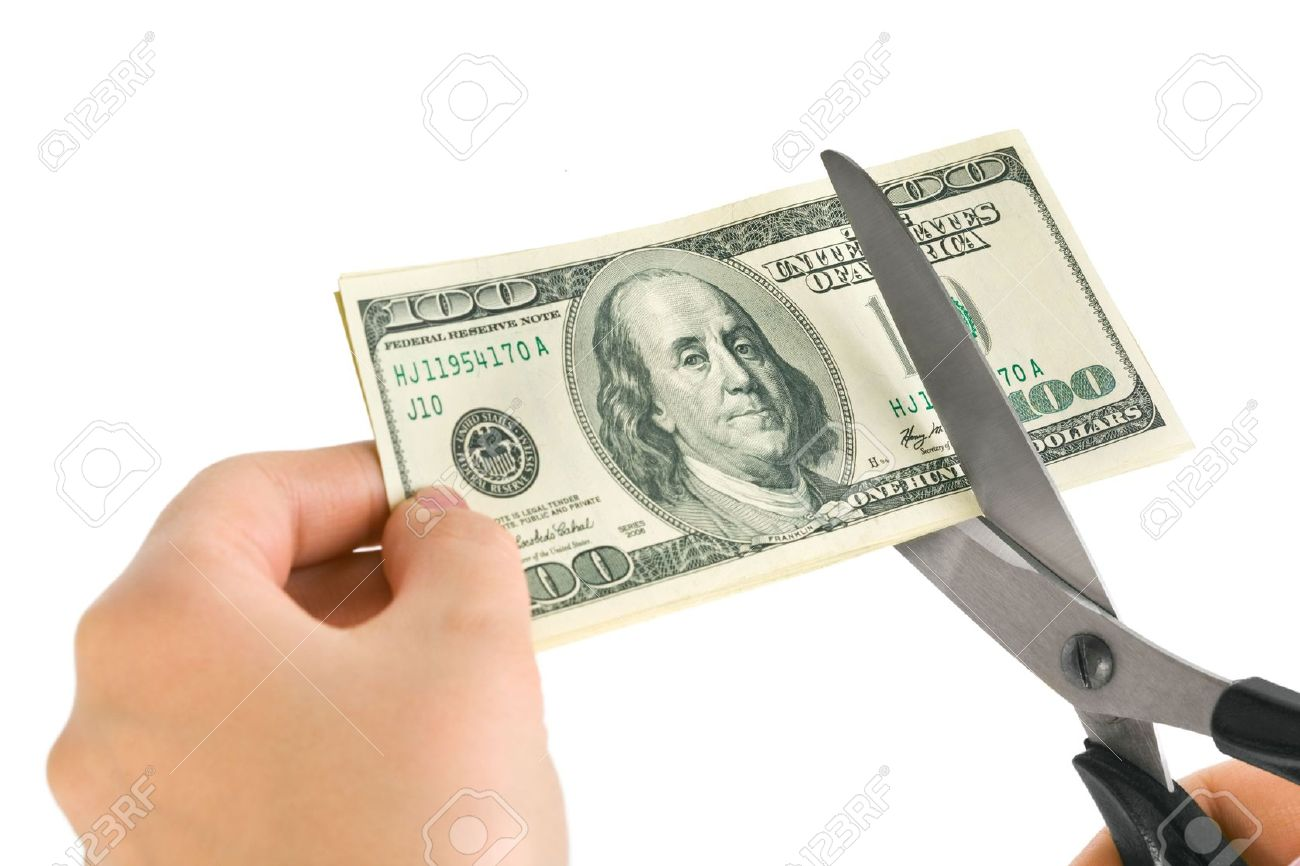 5889279-Hands-with-scissors-cutting-money-isolated-on-white-background-Stock-Photo[1]